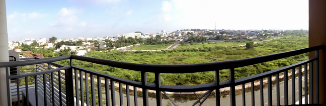 A panoramic view from my 5th-floor balcony, facing north as all buildings should in thee parts. The marshy area below is used for grazing by a local farmer who trucks in his big-ass cows most days, 3 or 4 of them. An interesting fact considering that what little Bien Hoa has for nightlife and fine dining is on a street 2 blocks away.
