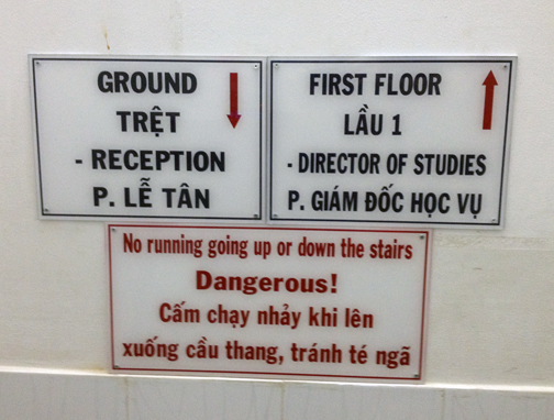 KTV English School sign - Do Not Run! Dangerous! - in English and Viet Namese.